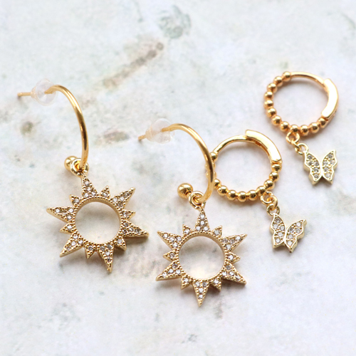 Trendy earrings and bracelets with zirconia charms and connectors: