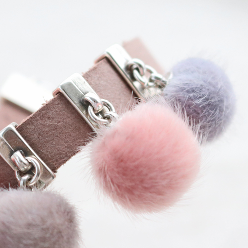Earrings and bracelets with new faux fur pompom beads and charms in soft colours