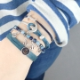 Bracelets and rings with anchors in blue shades