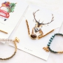Minimalist bracelets of faceted beads with new jewellery cards in winter wonderland style